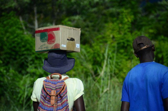 Man carrying box on head